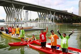 COLOURFUL DISPLAY: Some People's Association dragon boat team members will be wearing T-shirts with the words 'chase your rainbow SG100' to signify Singapore progressing into the next 50 years.