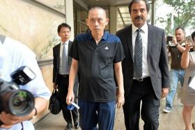 OUT: Alleged match-fixer Dan Tan leaving the Supreme Court building with his lawyers yesterday.