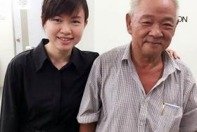 HELPING HAND: Ms Tin Pei Ling with cobbler Ng Ah Bah at her Meet-the-People Session on Monday.