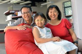 Above: With her parents, Mr Astro Chang and Madam Jackie Lee.