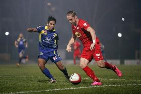 KEN CAN: Home United's Ken Ilso (in red) going up against Tampines Rovers' Jufri Taha during an S.League match which Home lost 3-2 on Nov 8.