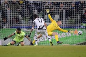 JOLT: (Below) Juventus striker Mario Mandzukic (centre) scoring the winner past Joe Hart (in yellow) after shrugging off City's Nicolas Otamendi (left).