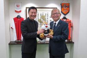 JAPAN-BOUND: Singapore Sports School principal Tan Teck Hock (left) receiving a mascot from J-League club Omiya Ardija's president Shigeru Suzuki after the Memorandum of Understanding signing last Sunday.