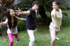 EXCITED: (Left) Madam Neo (centre) and her granddaughters, Venus (far left) and Nicole.