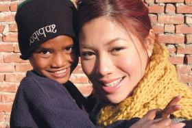 AT RISK: Belinda Lee with one of India's vulnerable street children, many of whom were abandoned.