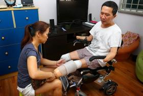 IMPROVISING: (Above) Madam Choong Siet Mei helping her husband, Mr Tan Whee Boon, to put on his prosthetic legs. Mr Tan showing how he uses a stylus-pen attached to a modified elastic band to type on his phone.