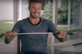 """David Beckham puts his """"bend it like Beckham"""" skills to the test in a video for People magazine."""