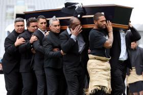 The casket of late New Zealand All Blacks rugby legend Jonah Lomu is carried after a memorial service at Eden Park in Auckland.