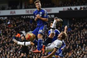 HARD FOUGHT: Chelsea defender Cesar Azpilicueta (far left) challenging Tottenham's Harry Kane as he attempts an overhead kick at goal.