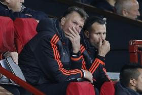 MEN UNITED: Manchester United manager Louis van Gaal (left) and his No. 2 Ryan Giggs have much to ponder.