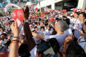 ARE YOU IN THE PICTURE?: Prime Minister Lee Hsien Loong taking a picture of Walkers (above) that he posted on his Facebook account yesterday.