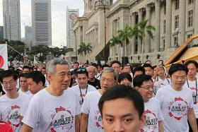 HISTORIC: Prime Minister Lee Hsien Loong and Singapore Press Holdings chairman Lee Boon Yang walking past the National Gallery.