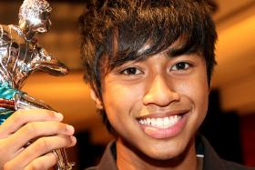 Ammirul Emmran Mazlan when he won the inaugural Dollah Kassim Award in 2010. The award recognises both footballing excellence and character