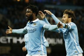 Wilfried Bony celebrating scoring the first goal for Manchester City with David Silva.