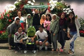 PROUD: National goalkeeper Izwan Mahbud (in black) headed to Matsumoto Yamaga yesterday morning for a one-week training stint in Japan, in the hope of being the first Singaporean footballer to secure a J.League contract.