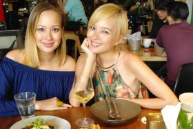 FABULOUS FOODIES: Teh Choy Wan (far left) and twin sister May Wan at one of their favourite lunch spots, Symmetry. Pan Seared Hokkaido Scallops Potato Fries with Truffle Oil Emulsion Saikyo Miso Cod and Mentaiko Carbonara