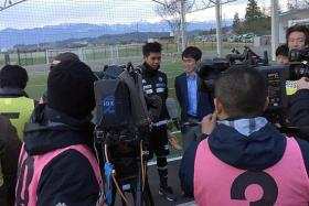 NEXT BIG THING? Singapore goalkeeper Izwan Mahbud (centre) at a TV interview after his first training session with J.League club Matsumoto Yamaga.