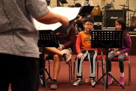 TALENTED: Isaiah rehearsing with other performers for the ChildAid concert.