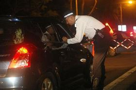 ROUNDING UP: Traffic Police conducted an island-wide operation during the early hours yesterday.