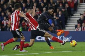 SUPER STATS: Daniel Sturridge (above, in black) has now scored 44 times in 73 appearances for the Reds, 