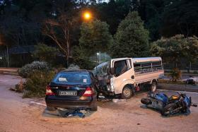 WRECKED: (Above) The three vehicles involved in the accident, which brought traffic to a crawl. The lorry's front portion was crumpled and the driver's side of the car was mangled. Three trees on the divider were also knocked down.