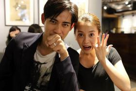 MR AND MRS: Taiwanese actor Vic Chou and his wife, Taiwanese actress Reen Yu, posing with their wedding bands.