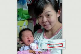"""Madam Zhang Yao Xin gave birth to her second child inside her husband's truck while on the way to the hospital. The place of birth stated in her baby's birth certificate is """"along SLE expressway""""."""