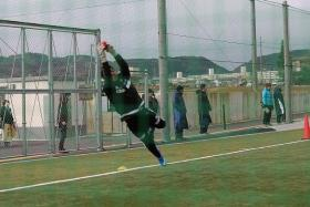BIG IN JAPAN: Izwan Mahmud showing his agility in saving a smaller ball used in training at J2 League side Matsumoto Yamaga (above). He is also a big hit with the fans at the club (inset).