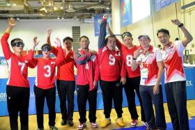 ALL SMILES: National Development Minister Lawrence Wong (third from left) poses with Singapore's goalball men's team.