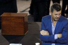 Marcelo Tinelli, TV celebrity and vice-president of Argentina's soccer club San Lorenzo de Almagro, stands next to the ballot box as he attends the AFA presidential election.
