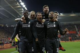 ON FORM: Liverpool (above) have won seven of their last eight games.