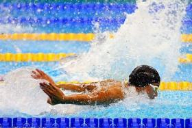 CLOSE CALL: Benson Tan (above) lost to Malaysia's Yoong Chung Wei by 0.06sec in the 50m butterfly.