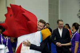 David Beckham surprised Asean Para Games athletes in Singapore on Dec 6, 2015. Here, he hugs a lucky Nila.
