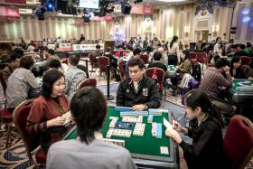 Contestants taking part in the World Series of Mahjong championship in Macau.