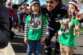 THE IZWAN FAN CLUB: (Above) Two young Japanese fans posing with Izwan Mahbud, who was much sought after by autographs-hunters in Japan.