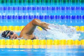SINGAPORE SHOWING: Theresa Goh (above) wins the women's 200m freestyle S5, while Toh Wei Soong finishes second in the men's 400m freestyle S8.