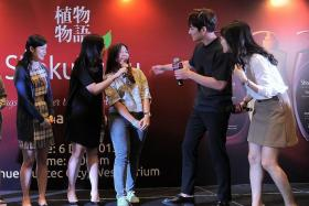 SPOTLIGHT: Local civil servant Patricia Sam (in jeans) learnt Korean for two years because of her love for her idol, actor Ji Chang Wook (second from right) whom she met yesterday.