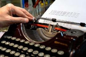 VINTAGE: Mr Chong pushes the paper to the side of the typewriter after completing a sentence. His fascination with the machines started when he gave a typewriter to his then-girlfriend.