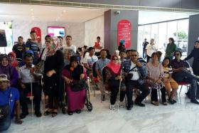 CONCERNED: Part of the tour group waiting for their rooms at the Lexis Hibiscus hotel at Port Dickson last Friday.