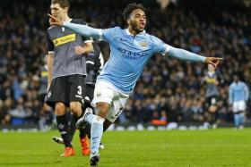 Raheem Sterling celebrates after scoring the third goal for Manchester City.