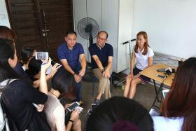 EMOTIONAL: (From left) Kovan murder victim Tan Boon Sin's younger son Tan Chee Wee, brother-in-law Ong Boon Kok and daughter Tan Siew Ling, speaking to the media at the Hillside Drive house.