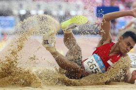 SUPER SUHAIRI: Singapore's Suhairi Suhani landing on the pit on his way to his silver in the men's long jump F20 class yesterday.