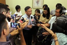 COMMENTS: Health Minister Gan Kim Yong speaking to reporters after the news conference.