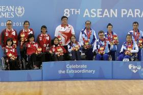 SECOND-BEST: The Singapore team (in red) have to settle for silver after losing to winners Thailand.
