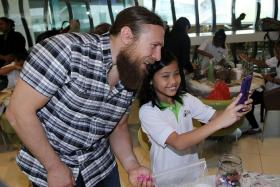 ACCOMMODATING: Daniel Bryan made time for wefies with the children at the terrarium-making workshop.