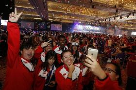 GLITTERING: Members of Team Singapore (above) having a blast at the closing ceremony, officiated by Prime Minister Lee Hsien Loong.
