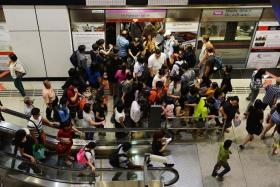 CUTTING AHEAD: Commuters sometimes encounter people who squeeze their way to the front of the line when trains arrive. The pictures above were taken at Dhoby Ghaut MRT station at 6pm yesterday.