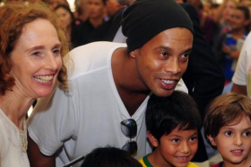 Ronaldinho meeting fans in Singapore at the launch of his football academy here.