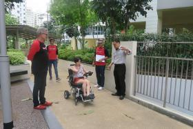 MOVING GIFT: (From left) ONE FM DJs The Flying Dutchman, Glenn Ong and Andre Hoeden, who presented the motorised wheelchair to Alicia, along with Rehab Mart's operations manager Edward Bu.