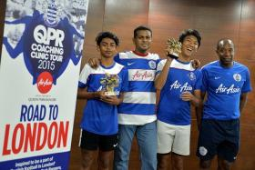 CHOSEN ONES: Nuruddin Irsyad Samion (above) and Effan Putra Ibrahim (second from far right), seen here with AirAsia Singapore CEO Loganathan Velaitham (second from left) and QPR Community Trust's Camp Director Martino Chevannes (far right), have been selected for a training stint with QPR.